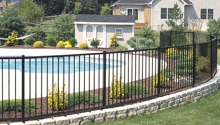 Pool fence and concrete pool deck